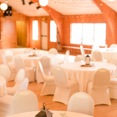 Photo of the round tables in the pavilion ready for a dance. Photo by Amber Langerud Photography